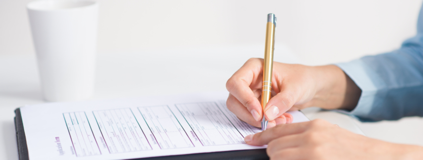 Closeup of candidate signing application form